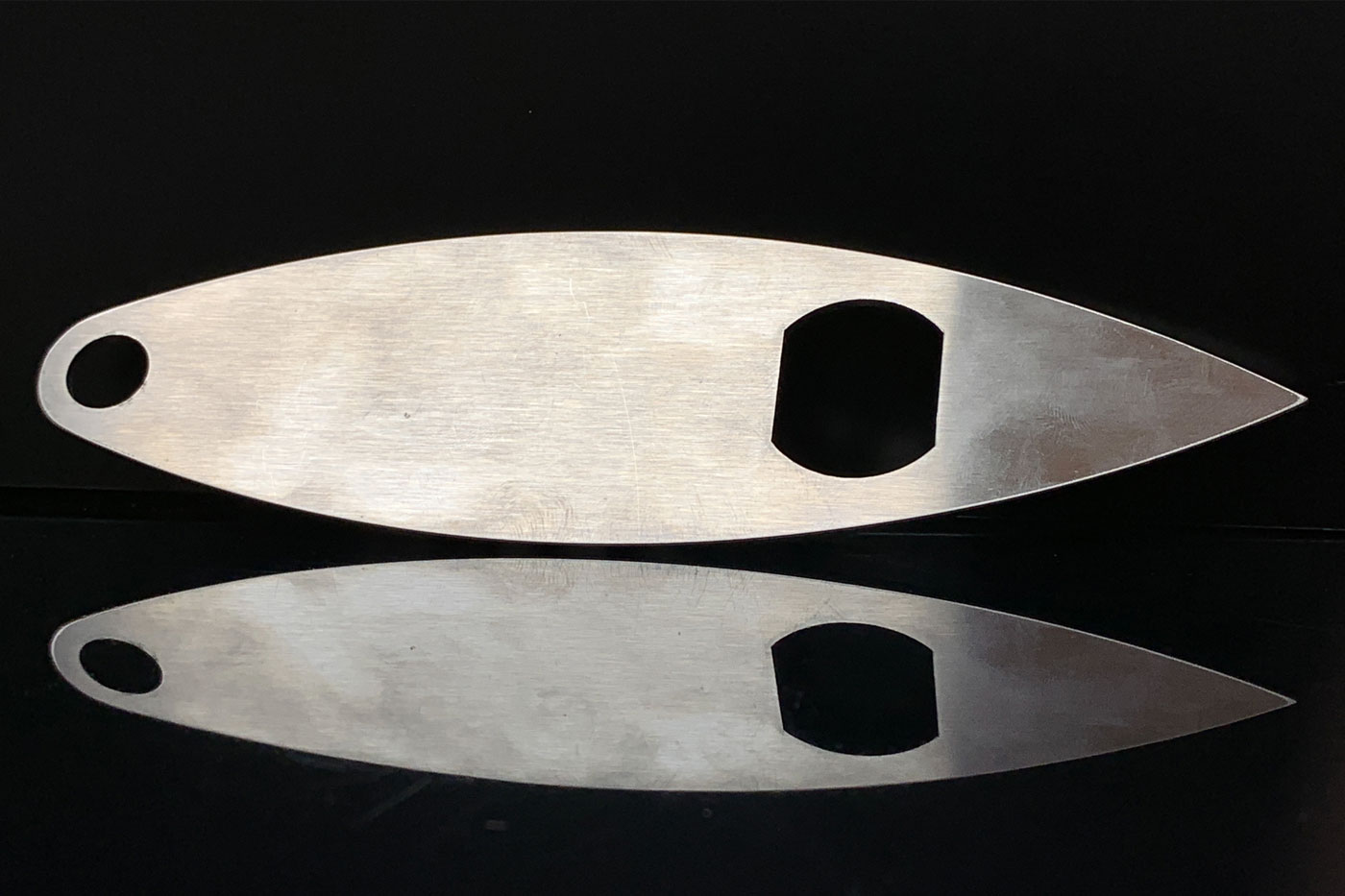 This boat-shaped bottle opener is made of 14 gauge stainless steel